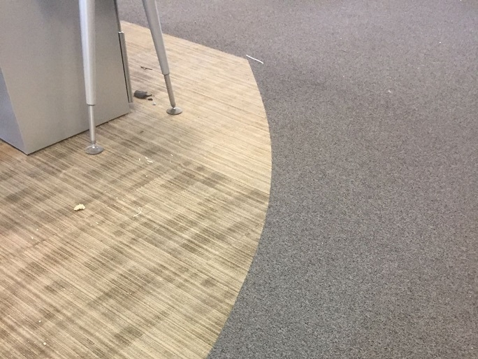 A close-up of the two different carpet tiles we installed.