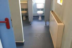 The vinyl flooring we installed in the men's community toilet block.