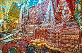 Persian rugs on a market stall in Shiraz
